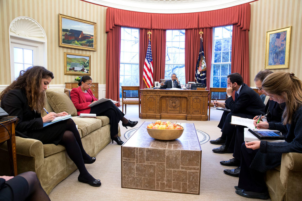 President Barack Obama talks on the phone with Chancellor Angela Merkel of Germany in the Oval Office, March 27, 2015. Attendees from left are Sahar Nowrouzzadeh, Director for Iran; National Security Advisor Susan E. Rice; Phil Gordon, White House Coordinator for the Middle East, North Africa, and the Gulf Region; Charles Kupchan, Senior Director for European Affairs and Avril Haines, Deputy National Security Advisor. (Official White House Photo by Pete Souza) This official White House photograph is being made available only for publication by news organizations and/or for personal use printing by the subject(s) of the photograph. The photograph may not be manipulated in any way and may not be used in commercial or political materials, advertisements, emails, products, promotions that in any way suggests approval or endorsement of the President, the First Family, or the White House.